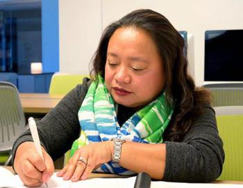 Woman taking notes at a desk